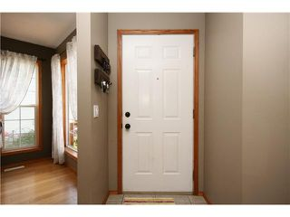 Photo 3: 128 QUIGLEY Close: Cochrane Residential Attached for sale : MLS®# C3605287