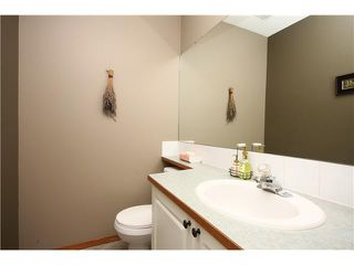 Photo 9: 128 QUIGLEY Close: Cochrane Residential Attached for sale : MLS®# C3605287