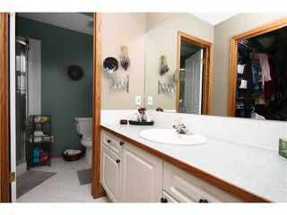 Photo 15: 128 QUIGLEY Close: Cochrane Residential Attached for sale : MLS®# C3605287
