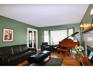 Photo 4: 3922 ROBIN Place in Port Coquitlam: Oxford Heights House for sale : MLS®# V1106174
