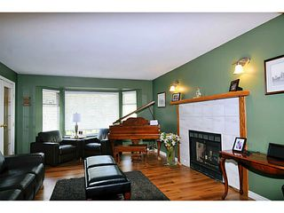 Photo 3: 3922 ROBIN Place in Port Coquitlam: Oxford Heights House for sale : MLS®# V1106174