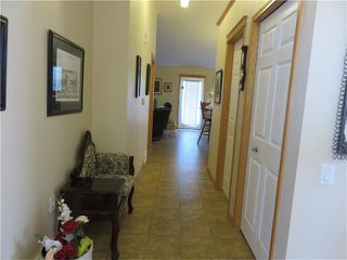 Photo 4: 301 Whispering Way: Vulcan House for sale : MLS®# C4042779