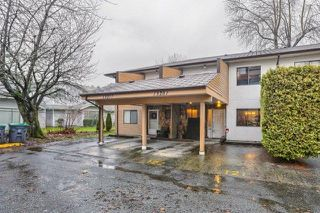 "Photo 1: 13281 71B Avenue in Surrey: West Newton Townhouse for sale in ""SunCreek"" : MLS®# R2238467"