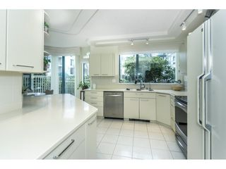 """Photo 2: 107 1725 MARTIN Drive in Surrey: Sunnyside Park Surrey Condo for sale in """"Southwynd"""" (South Surrey White Rock)  : MLS®# R2339886"""