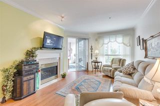 """Photo 3: 328 3098 GUILDFORD Way in Coquitlam: North Coquitlam Condo for sale in """"Marlborough House"""" : MLS®# R2367049"""