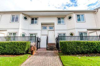 "Photo 1: 12 12915 16 Avenue in Surrey: Crescent Bch Ocean Pk. Townhouse for sale in ""Ocean Park Village"" (South Surrey White Rock)  : MLS®# R2010405"