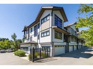 """Photo 1: 201 13585 16 Avenue in Surrey: Crescent Bch Ocean Pk. Townhouse for sale in """"Bayview Terrace"""" (South Surrey White Rock)  : MLS®# R2288990"""