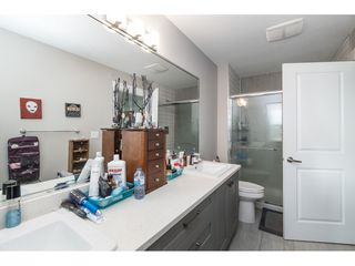 """Photo 13: 20994 77A Avenue in Langley: Willoughby Heights Condo for sale in """"IVY ROW"""" : MLS®# R2381955"""