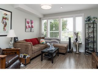 """Photo 4: 20994 77A Avenue in Langley: Willoughby Heights Condo for sale in """"IVY ROW"""" : MLS®# R2381955"""