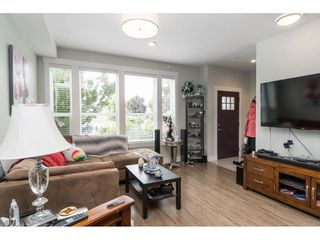 """Photo 5: 20994 77A Avenue in Langley: Willoughby Heights Condo for sale in """"IVY ROW"""" : MLS®# R2381955"""