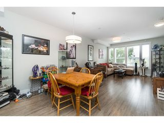 """Photo 3: 20994 77A Avenue in Langley: Willoughby Heights Condo for sale in """"IVY ROW"""" : MLS®# R2381955"""