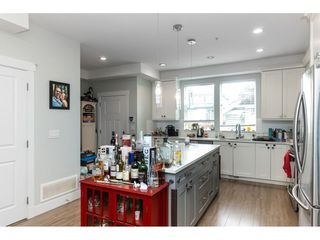 """Photo 7: 20994 77A Avenue in Langley: Willoughby Heights Condo for sale in """"IVY ROW"""" : MLS®# R2381955"""