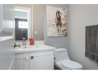 """Photo 9: 20994 77A Avenue in Langley: Willoughby Heights Condo for sale in """"IVY ROW"""" : MLS®# R2381955"""