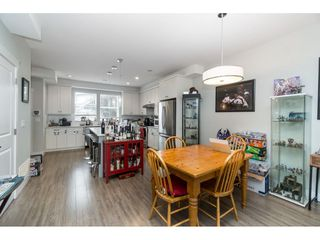 """Photo 6: 20994 77A Avenue in Langley: Willoughby Heights Condo for sale in """"IVY ROW"""" : MLS®# R2381955"""