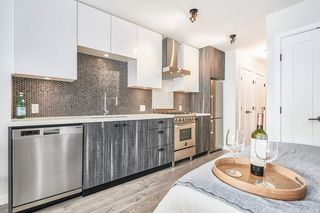 """Photo 5: 412 311 E 6TH Avenue in Vancouver: Mount Pleasant VE Condo for sale in """"THE WOHLSIEN"""" (Vancouver East)  : MLS®# R2501073"""