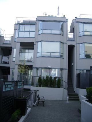 Photo 6: RAINSCREENED Fairview Townhouse!