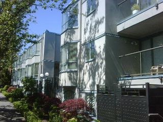 Photo 2: RAINSCREENED Fairview Townhouse!