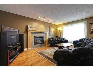 Photo 7: 228 WESTPOINT Gardens SW in Calgary: 2 Storey for sale : MLS®# C3555793