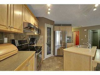 Photo 4: 228 WESTPOINT Gardens SW in Calgary: 2 Storey for sale : MLS®# C3555793