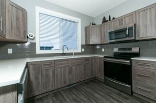 Photo 1: 6156 ROSENTHAL Way in Edmonton: Zone 58 Attached Home for sale : MLS®# E4183155