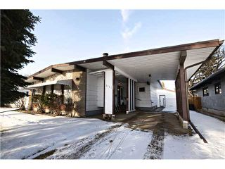 Photo 1: 3112 LANCASTER Way SW in Calgary: Lakeview House for sale : MLS®# C3654230