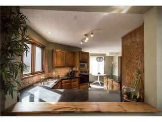 Photo 10: 5947 COACH HILL Road SW in Calgary: Coach Hill House for sale : MLS®# C4056970