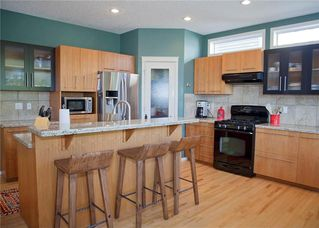 Photo 8: 82 DRAKE LANDING Common: Okotoks House for sale : MLS®# C4137553