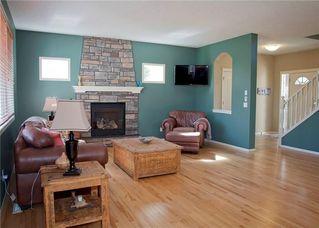 Photo 16: 82 DRAKE LANDING Common: Okotoks House for sale : MLS®# C4137553