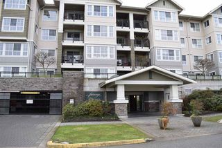 "Photo 1: 305 19673 MEADOW GARDENS Way in Pitt Meadows: North Meadows PI Condo for sale in ""THE FAIRWAYS"" : MLS®# R2237008"