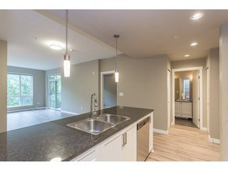 """Photo 8: 104 2238 WHATCOM Road in Abbotsford: Abbotsford East Condo for sale in """"Waterleaf"""" : MLS®# R2260128"""