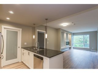"""Photo 4: 104 2238 WHATCOM Road in Abbotsford: Abbotsford East Condo for sale in """"Waterleaf"""" : MLS®# R2260128"""