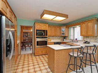 Photo 7: 7940 BURNLAKE Drive in Burnaby: Government Road House for sale (Burnaby North)  : MLS®# R2281808