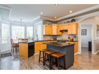 """Photo 7: 6218 166A Street in Surrey: Cloverdale BC House for sale in """"Clover Ridge Estates"""" (Cloverdale)  : MLS®# R2316514"""
