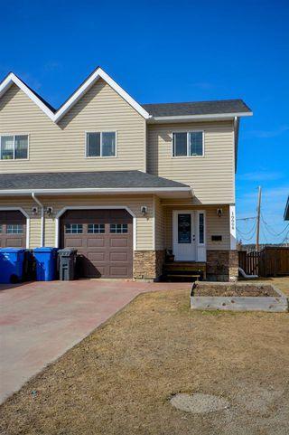 Photo 1: 10008 112 Avenue in Fort St. John: Fort St. John - City NW Duplex for sale (Fort St. John (Zone 60))  : MLS®# R2359590