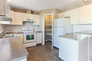 Photo 9: 1106 PRAIRIE SOUND Circle NW: High River Row/Townhouse for sale : MLS®# C4239510