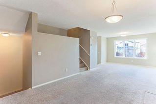 Photo 5: 1106 PRAIRIE SOUND Circle NW: High River Row/Townhouse for sale : MLS®# C4239510