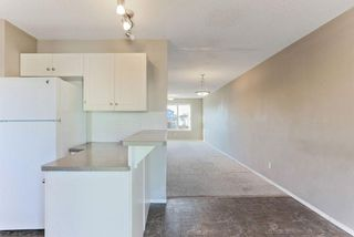 Photo 10: 1106 PRAIRIE SOUND Circle NW: High River Row/Townhouse for sale : MLS®# C4239510