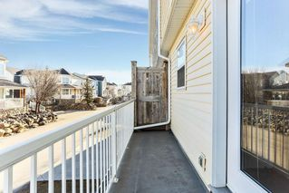 Photo 2: 1106 PRAIRIE SOUND Circle NW: High River Row/Townhouse for sale : MLS®# C4239510