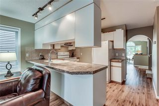 Photo 9: 239 COACHWAY Road SW in Calgary: Coach Hill Detached for sale : MLS®# C4258685