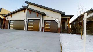 Photo 2: 20 Cranbrook Mews SE in Calgary: Cranston Semi Detached for sale : MLS®# A1020402
