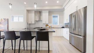Photo 4: 20 Cranbrook Mews SE in Calgary: Cranston Semi Detached for sale : MLS®# A1020402