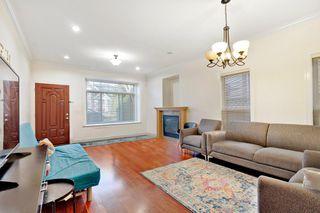 Photo 2: 7486 ELWELL Street in Burnaby: Highgate 1/2 Duplex for sale (Burnaby South)  : MLS®# R2520924