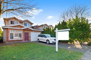 Photo 1: 7486 ELWELL Street in Burnaby: Highgate 1/2 Duplex for sale (Burnaby South)  : MLS®# R2520924