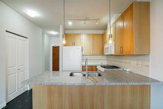 """Photo 1: 427 15918 26 Avenue in Surrey: Grandview Surrey Condo for sale in """"The Morgan"""" (South Surrey White Rock)  : MLS®# R2242399"""
