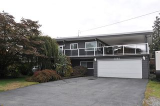 Photo 1: 1268 TAMARACK Place in Port Coquitlam: Birchland Manor House for sale : MLS®# R2355492
