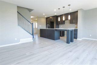 Photo 2: 2340 WONNACOTT Crescent in Edmonton: Zone 53 House Half Duplex for sale : MLS®# E4150600
