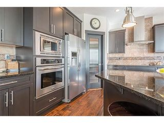 Photo 4: 12 ROCKFORD Terrace NW in Calgary: Rocky Ridge House for sale : MLS®# C4050751