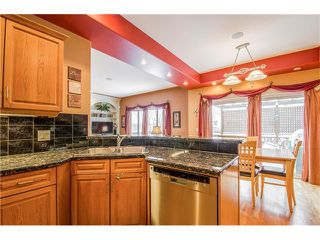 Photo 10: 243 STRATHRIDGE Place SW in Calgary: Strathcona Park House for sale : MLS®# C4101454