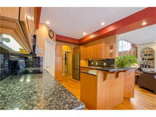 Photo 9: 243 STRATHRIDGE Place SW in Calgary: Strathcona Park House for sale : MLS®# C4101454