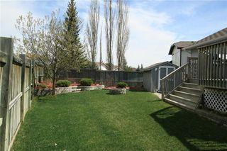 Photo 38: 306 WEST TERRACE Place: Cochrane House for sale : MLS®# C4117766